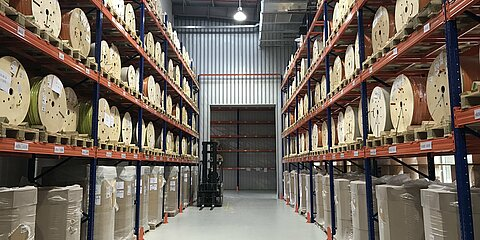 High-bay warehouse with cable coils